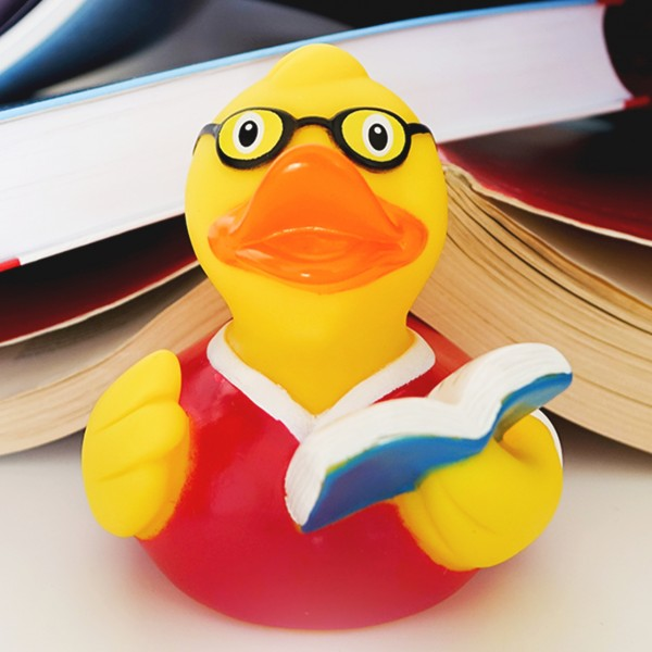LILALU rubber duck bookreader in front of books