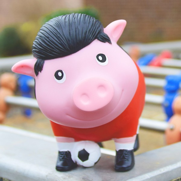 LILALU BIGGYS piggy bank soccer player on a foosball table