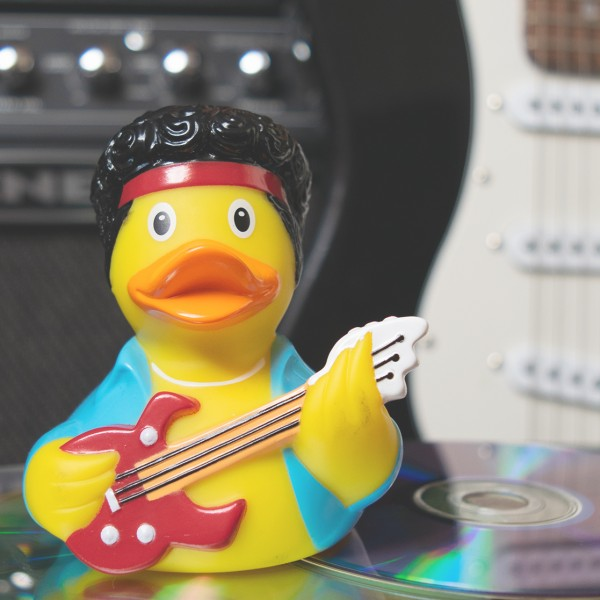 LILALU rubber duck Rockstar in front of a guitar
