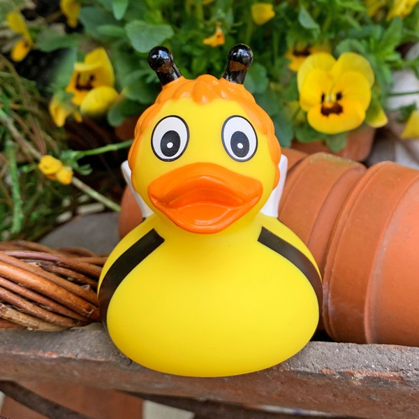 LILALU rubber duck bee Susi in front of a flowerpot