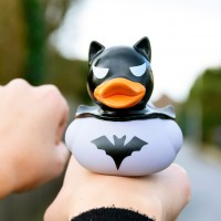 LILALU rubber duck dark duck grey on a hand