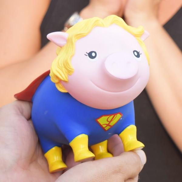 LILALU BIGGYS piggy bank Superheroine holding in hands