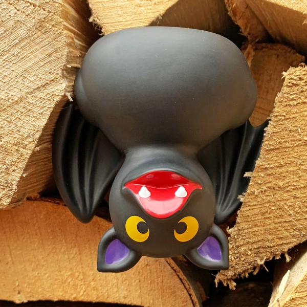 LILALU rubber duck bat in a stack of wood