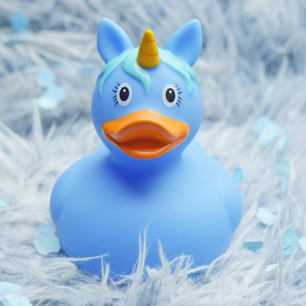 LILALU rubber duck unicorn light blue on a fur rug