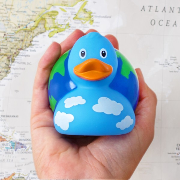 LILALU rubber duck globe in front of a map