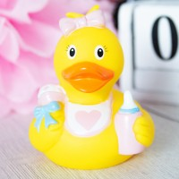 LILALU rubber duck baby girl in front of a pink flower