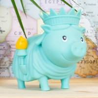 LILALU BIGGYS piggy bank Freedom in front of a map
