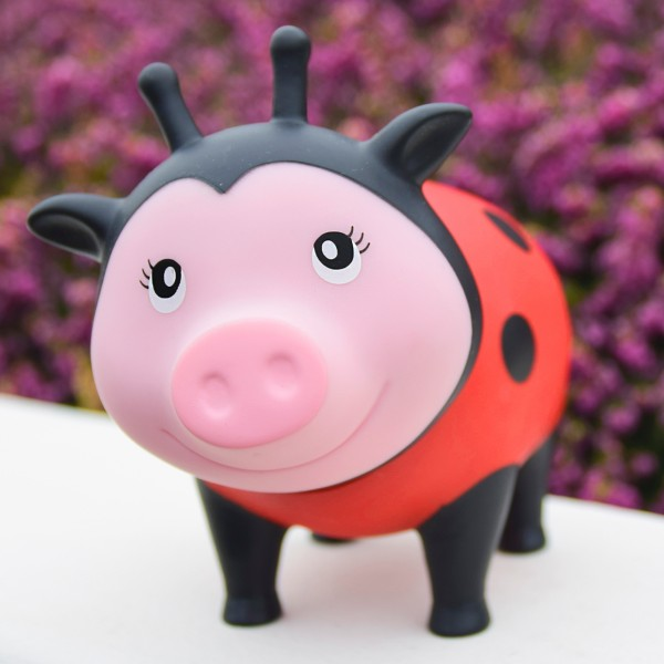 LILALU BIGGYS piggy bank Ladybug in front of flowers